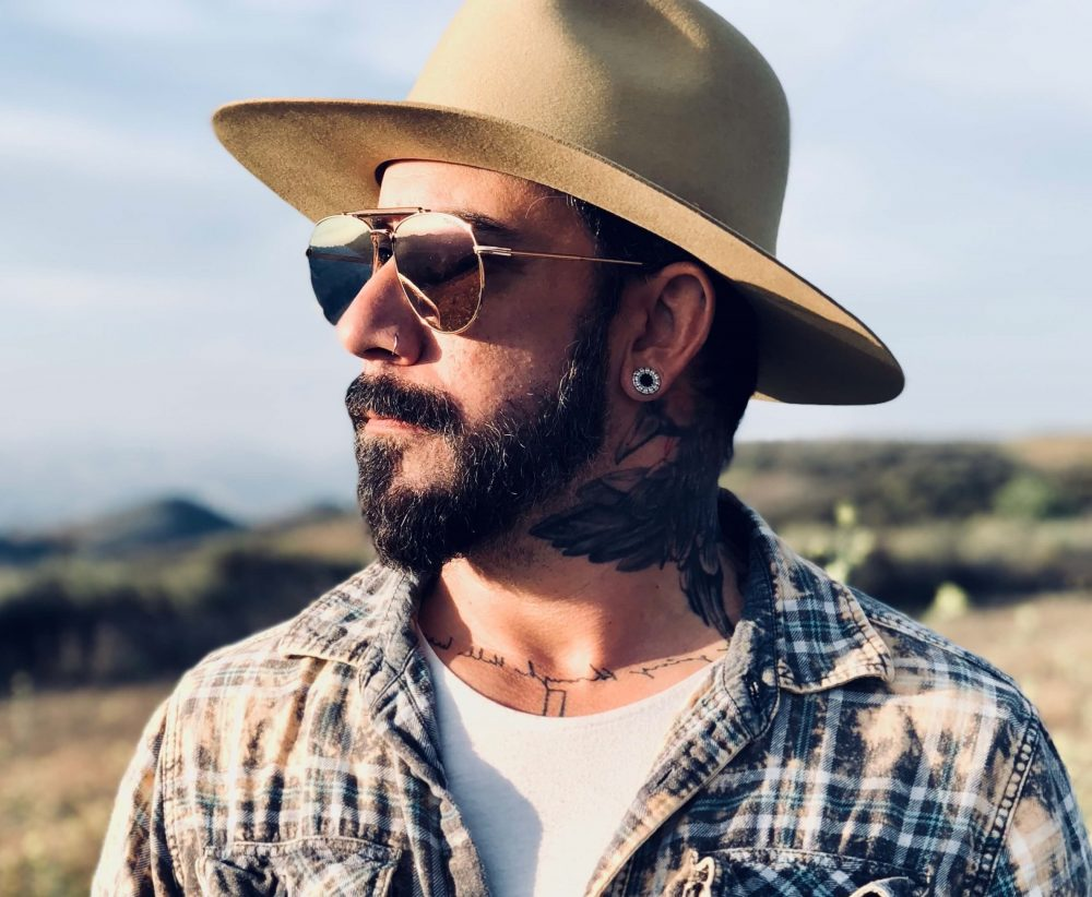 AJ McLean Celebrates Lifelong Romance in 'Boy and a Man' Video